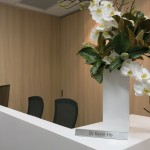 Reception area with name plate and exotic floral arrangement