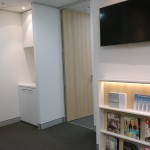 Dr Kevin Ho waiting room with TV & bookcase